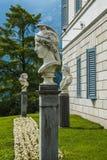 Bellagio city on Lake Como, Italy. Lombardy region. Italian famous landmark, Villa Melzi Park. sculpture of Men head Royalty Free Stock Photography