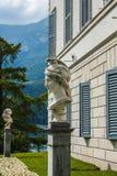 Bellagio city on Lake Como, Italy. Lombardy region. Italian famous landmark, Villa Melzi Park. sculpture of Men head Stock Images