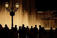 Bellagio dancing fountains people silhouettes. Crowd watches Bellagio dancing fountains in the night Stock Images