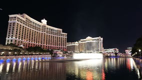Bellagio Fountains and Caesars Palace Resorts. Editorial night time lapse of the Bellagio fountains and Caesars Place resorts on the Las Vegas strip stock video footage