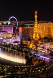 Bellagio Fountains opposite Paris Las Vegas at night stock photos