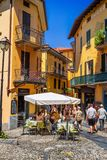 View of street restaurant in old Bellagio. BELLAGIO, ITALY - AUGUST 03, 2015: View of street restaurant in old Bellagio, Como lake, Italy Royalty Free Stock Images