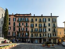 Bellagio, Italy  March 30 2019 Town Square next to San Giacomo Church. Bellagio, Italy  March 30 2019 Town Square, fountain and local business next to San royalty free stock images