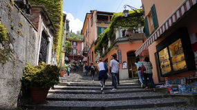 BELLAGIO, ITALY - MAY 14, 2017: tourists in Salita Serbelloni picturesque small town street view in Bellagio, Lake Como, Italy. Stock Photos