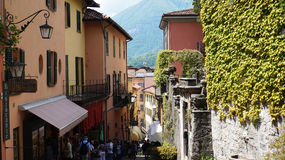 BELLAGIO, ITALY - MAY 14, 2017: tourists in Salita Serbelloni picturesque small town street view in Bellagio, Lake Como, Italy. Royalty Free Stock Photos