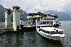 BELLAGIO, ITALY - MAY 14, 2017: two ferries moored in the harbor of Bellagio, Lake Como, Italy Royalty Free Stock Images