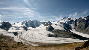 Bellavista & Piz Bernina and glaciers in the valley seen from Diavolezza and Munt Pars. Royalty Free Stock Images