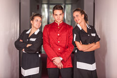 Bellboy with Chambermaids Royalty Free Stock Photos