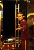 Bellboy or concierge. In welcome pose Stock Image