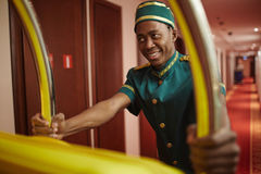 Bellboy Delivering Bags in Hotel Stock Photos