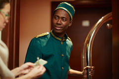 Bellboy Getting Tips from Guests Royalty Free Stock Image
