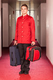 Bellboy with Luggages. In the Hallway Royalty Free Stock Photography
