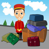 Bellboy standing near luggage Royalty Free Stock Image