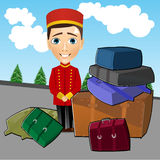 Bellboy standing near luggage Royalty Free Stock Photo