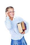 Belle écolière en glaces avec des livres. photographie stock
