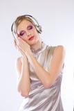 Belle électro fille de bruit dans des écouteurs. Photo libre de droits
