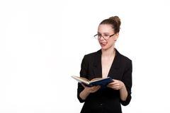 Belle étudiante avec un livre Images libres de droits