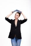 Belle étudiante avec un livre Photo stock