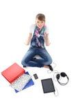 Belle adolescente avec le PC, le téléphone et les écouteurs de tablette Photographie stock
