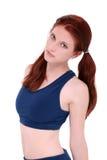 Belle adolescente dans des vêtements de séance d'entraînement au-dessus de blanc Image libre de droits