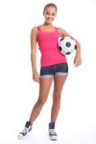 Belle adolescente de footballeur avec la bille Image libre de droits