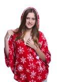 Belle adolescente gaie posant dans le studio Hoodie rouge de port d'hiver avec des flocons de neige D'isolement sur le fond blanc Images stock