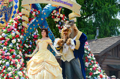Belle and the Beast from the Festival of Fantasy Parade. ORLANDO - MAY 2014: Belle and the Beast from the Festival of Fantasy Parade at the Magic Kingdom, Walt Royalty Free Stock Photos