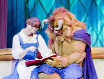Belle and Beast Read a Book. GREEN BAY, WI - FEBRUARY 10: Belle and Beasty from Beauty and the Beast read a book at the Disney Princesses show at the Resch Stock Photos
