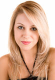 Belle blonde d'isolement sur le blanc Photographie stock libre de droits