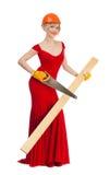 Belle blonde dans une robe rouge avec un foret électrique Image stock