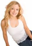 Belle blonde de sourire d'isolement sur le blanc Photographie stock