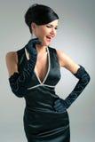Belle brune dans une robe noire Photographie stock libre de droits