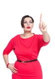 Belle brune plus la femme de taille faisant le choix Photographie stock libre de droits