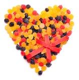 Belle caramelle dolci nella figura del cuore Fotografia Stock