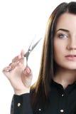 Belle coiffeuse de fille sur le fond clair Photographie stock libre de droits