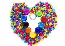 Belle couleur de pierres et de bouteilles de coeur de d'isolement sur le CCB blanc Photographie stock