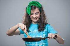 Belle cuisson de fille Photographie stock libre de droits