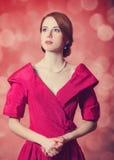 Belle donne della testarossa. fotografia stock