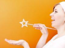 Belle et heureuse fée avec la baguette magique Photographie stock libre de droits