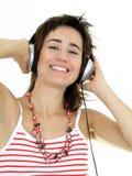 Belle femme appréciant la musique Images libres de droits