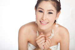 Belle femme asiatique de portrait dans la robe de mariage blanche Photo stock