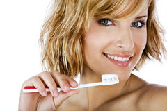 Belle femme avec la brosse à dents et la pâte Images stock