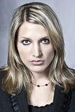 Belle femme blonde sérieuse Photographie stock libre de droits