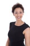 Belle femme d'affaires dans la robe noire souriant à l'isolat d'appareil-photo images libres de droits