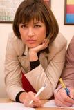 Belle femme d'affaires pensive Photo libre de droits