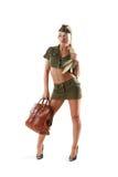 Belle femme dans des vêtements militaires avec le sac Photographie stock libre de droits