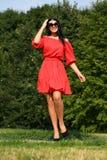 Belle femme dans la robe rouge Images libres de droits