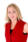 Belle femme dans le procès sans manche rouge d'affaires Image stock