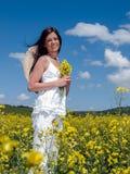 Belle femme dans le viol de floraison Image stock