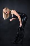 Belle femme dans un corset avec un fouet photographie stock